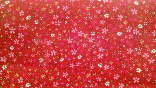 Tissu coton petites fleurs fond rouge