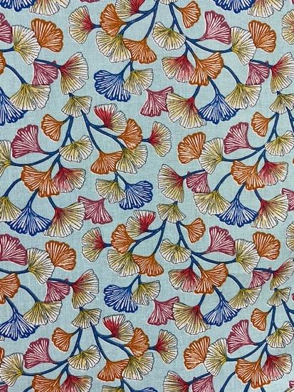 Tissu coton nénuphars multicolore fond bleu ciel