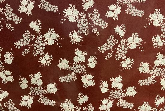 Tissu vinyle fleurs bleues fond marron